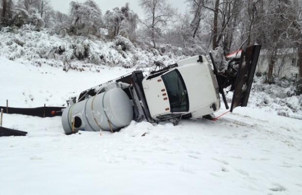 City Snow Truck Overturns In Creek